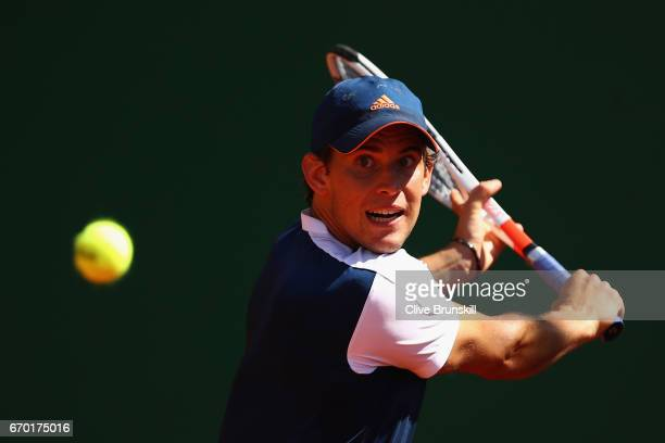 Dominic Thiem of Austria plays a backhand against Robin Haase of the Netherlands in his second round match on day four of the Monte Carlo Rolex...