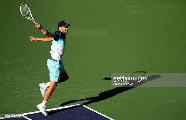 Dominic Thiem of Austria plays a backhand against Roger Federer of Switzerland during their men's singles final on day fourteen of the BNP Paribas...