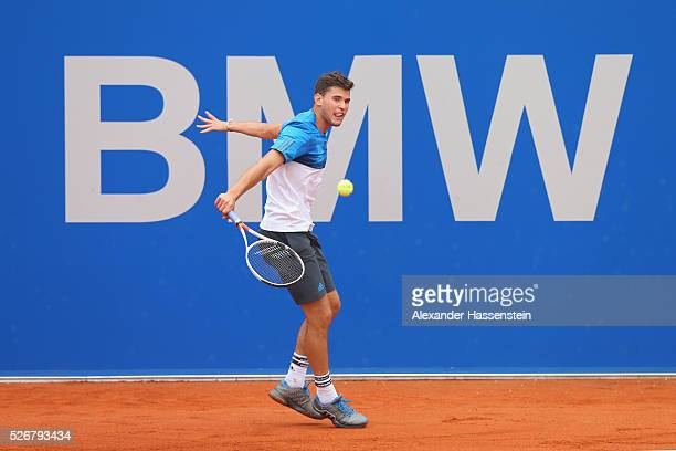 Dominic Thiem of Austria plays a backhand during his finale match against Philipp Kohlschreiber of Germany of the BMW Open at Iphitos tennis club on...