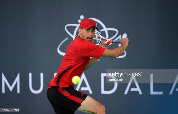 Dominic Thiem of Austria plays a backhand during his match against Pablo Carreno Busta of Spain on day three of the Mubadala World Tennis...