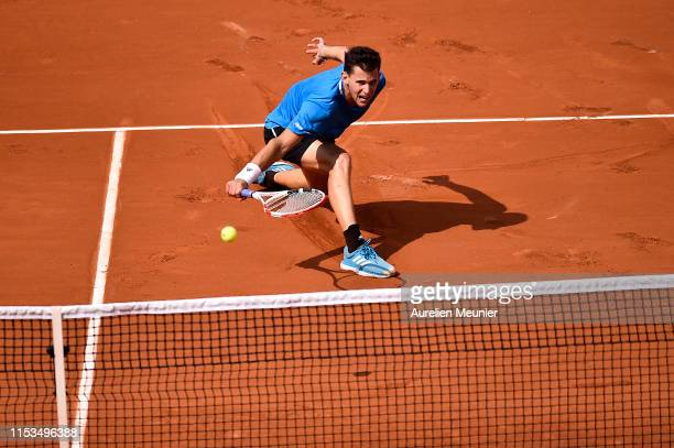 Dominic Thiem of Austria plays a backhand during his mens singles fourth round match against Gael Monfils of France during day nine of the 2019...