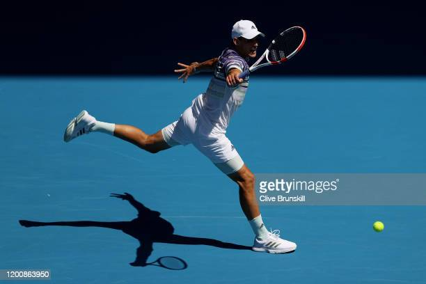 Dominic Thiem of Austria plays a backhand during his Men's Singles first round match against Adrian Mannarino of France on day two of the 2020...