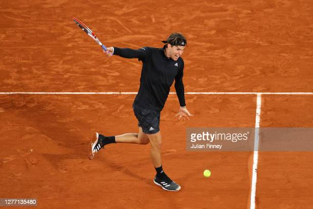 Dominic Thiem of Austria plays a backhand during his Men's Singles first round match against Marin Cilic of Croatia on day two of the 2020 French...