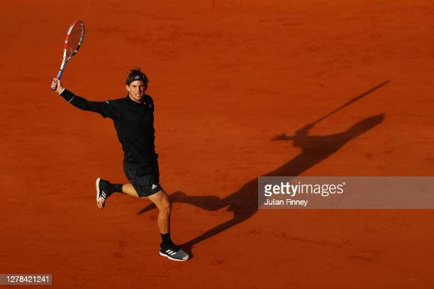 Dominic Thiem of Austria plays a backhand during his Men's Singles fourth round match against Hugo Gaston of France on day eight of the 2020 French...