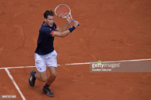 Dominic Thiem of Austria plays a backhand during his men's singles semifinal match against Marco Cecchinato of Italia on day 13 of the 2018 French...