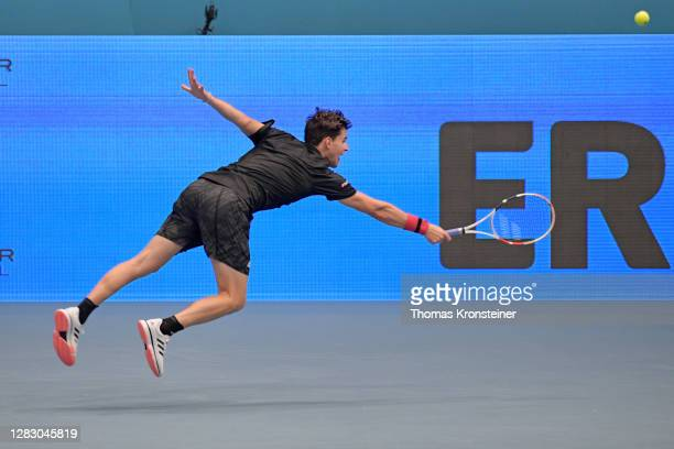 Dominic Thiem of Austria plays a backhand during his quarter finals match against Andrey Rublev of Russia on day seven of the Erste Bank Open tennis...