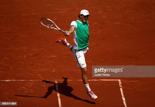Dominic Thiem of Austria plays a backhand during the mens singles second round match against Simone Bolleli of Italy on day four of the 2017 French...