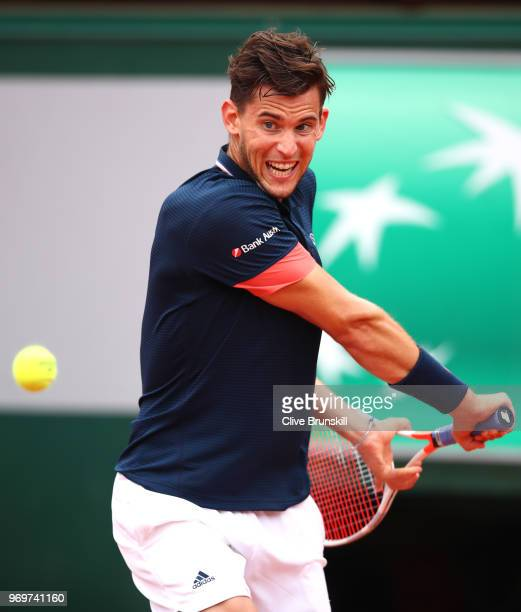 Dominic Thiem of Austria plays a backhand during the mens singles semifinal match against Marco Cecchinato of Italy during day thirteen of the 2018...