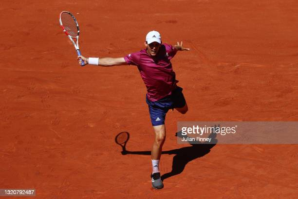 Dominic Thiem of Austria plays a backhand in his First Round match against Pablo Andujar of Spain during Day One of the 2021 French Open at Roland...