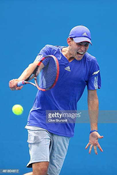 Dominic Thiem of Austria plays a backhand in his first round match against Roberto Bautista Agut of Spain during day two of the 2015 Australian Open...