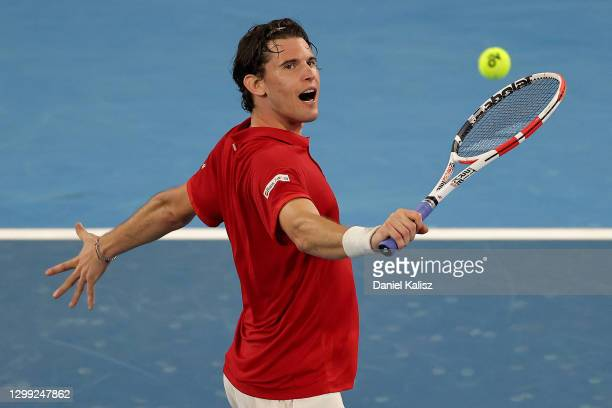 Dominic Thiem of Austria plays a backhand in his match against Rafael Nadal of Spain during the 'A Day at the Drive' exhibition tournament at...