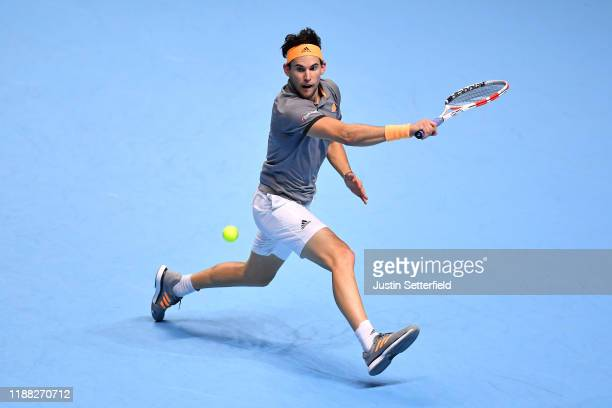 Dominic Thiem of Austria plays a backhand in his singles final match against Stefanos Tsitsipas of Greece during Day 8 of the Nitto ATP Finals at The...