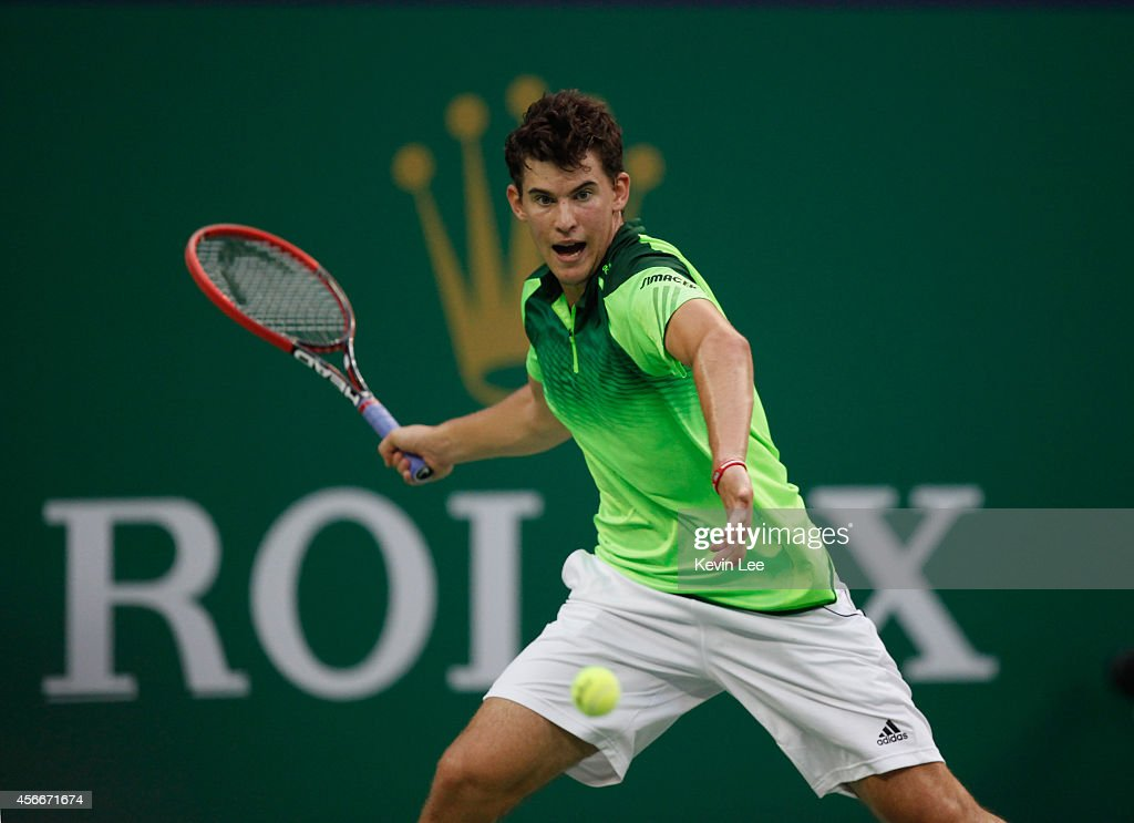 Dominic Thiem of Austria plays a forehand against Lukas Rosol of Czech Republic during his match at day 1 of the Shanghai Rolex Masters at Zi Zhong stadium on October 5, 2014 in Shanghai, China.