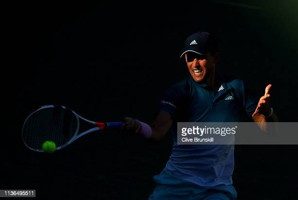 Dominic Thiem of Austria plays a forehand against Roger Federer of Switzerland during their men's singles final on day fourteen of the BNP Paribas...