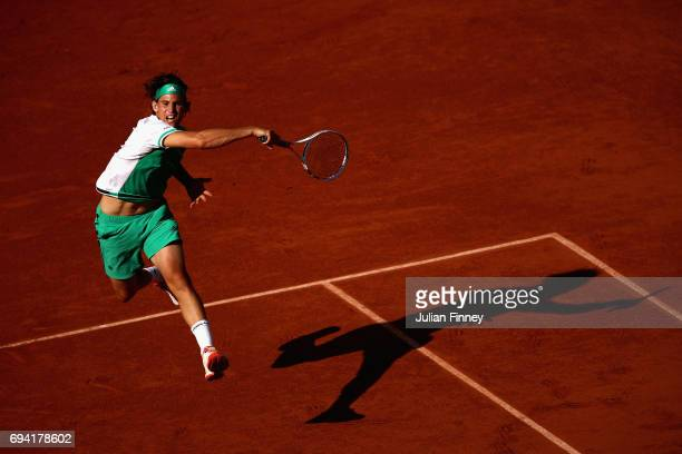 Dominic Thiem of Austria plays a forehand during mens singles semifinal match against Rafael Nadal of Spain on day thirteen of the 2017 French Open...