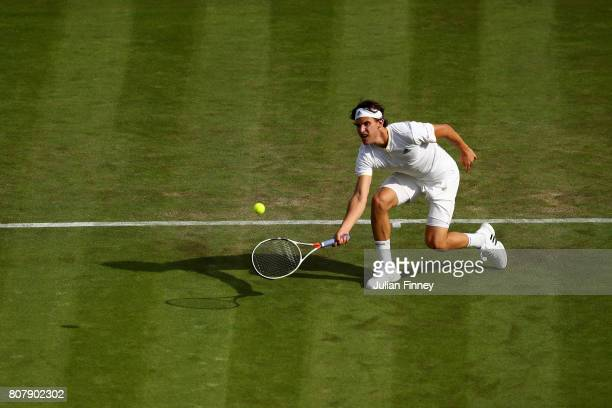 Dominic Thiem of Austria plays a forehand during the Gentlemen's Singles first round match against Vasek Pospisil of Canada on day two of the...