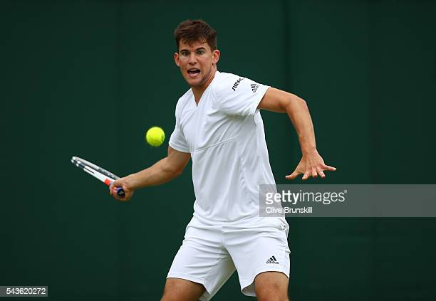 Dominic Thiem of Austria plays a forehand during the Men's Singles first round match against Florian Mayer of Germany on day three of the Wimbledon...