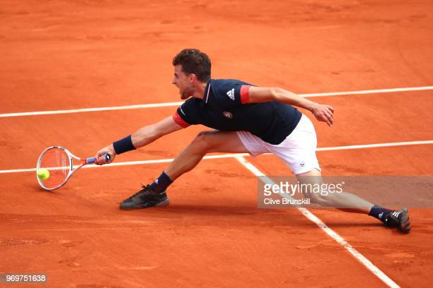 Dominic Thiem of Austria plays a forehand during the mens singles semifinal match against Marco Cecchinato of Italy during day thirteen of the 2018...