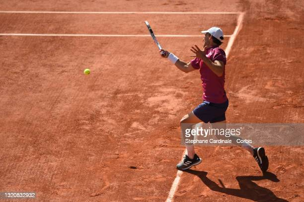 Dominic Thiem of Austria plays a forehand in his First Round match against Pablo Andujar of Spain during Day One of the 2021 French Open at Roland...