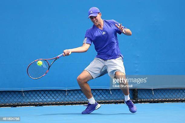 Dominic Thiem of Austria plays a forehand in his first round match against Roberto Bautista Agut of Spain during day two of the 2015 Australian Open...