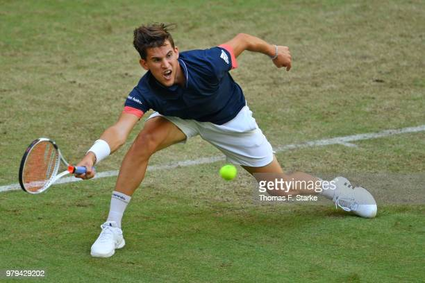 Dominic Thiem of Austria plays a forehand in his match against Yuichi Sugita of Japan during day three of the Gerry Weber Open at Gerry Weber Stadium...