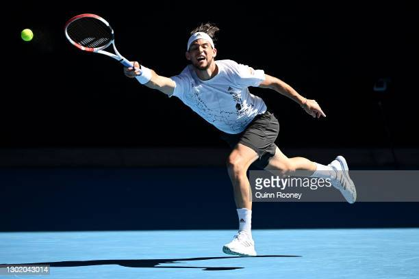 Dominic Thiem of Austria plays a forehand in his Men's Singles fourth round match against Grigor Dimitrov of Bulgaria during day seven of the 2021...