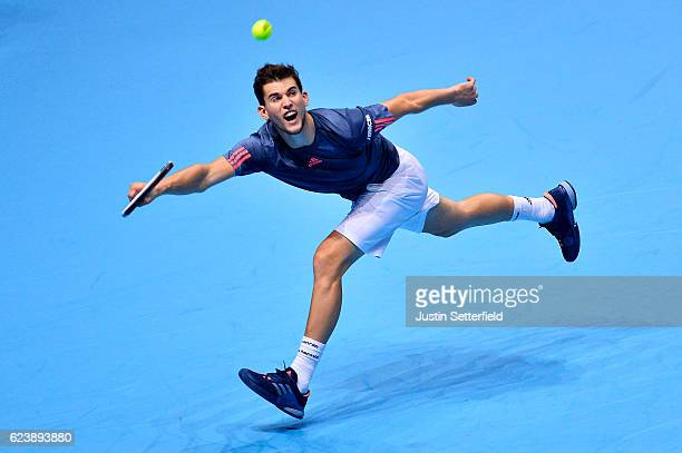 Dominic Thiem of Austria plays a forehand in his men's singles match against Milos Raonic of Canada on day five of the ATP World Tour Finals at O2...