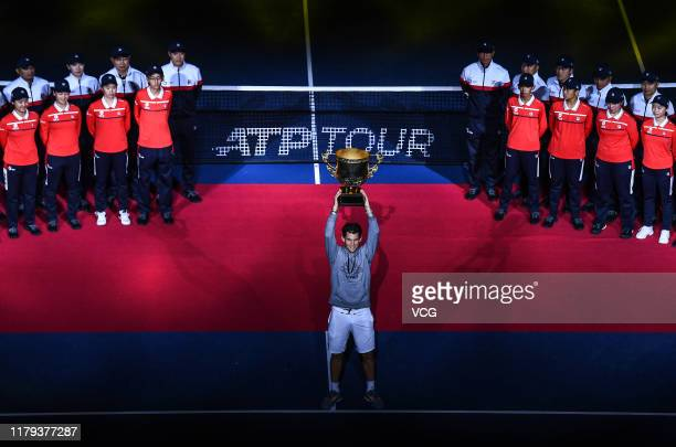 Dominic Thiem of Austria poses with the champion trophy after the Men's Singles final match against Stefanos Tsitsipas of Greece on Day nine of 2019...