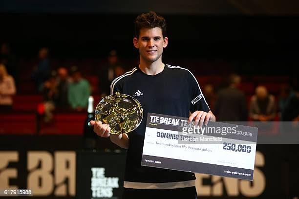 Dominic Thiem of Austria poses with the trophy and the cheque after victory in the final match against Andy Murray of Great Britain during Tie Break...