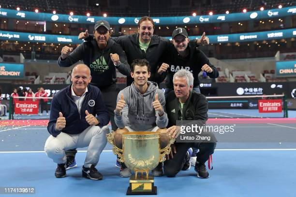 Dominic Thiem of Austria poses with the trophy celebrate with team after win the Men's Singles final match against Stefanos Tsitsipas of Greece on...