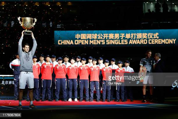 Dominic Thiem of Austria poses with the trophy during the medal ceremony after the Men's singles final match against Stefanos Tsitsipas of Greece on...