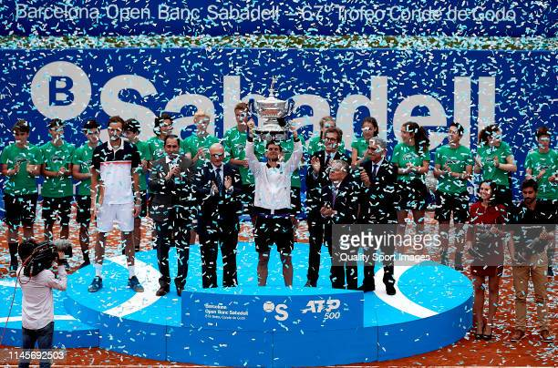 Dominic Thiem of Austria posses with the championship trophy on day seven of the Barcelona Open Banc Sabadell at Real Club De Tenis Barcelona on...