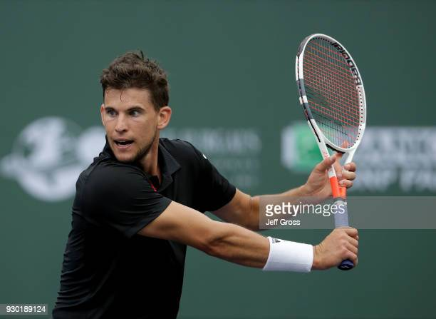Dominic Thiem of Austria prepares to return a backhand to Stefanos Tsitsipas of Greece during the BNP Paribas Open on March 10 2018 at the Indian...