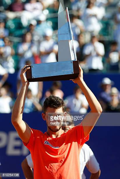 Dominic Thiem of Austria raises the trophy after winning his final match against Nicolas Almagro of Spain as part of ATP Argentina Open at Buenos...