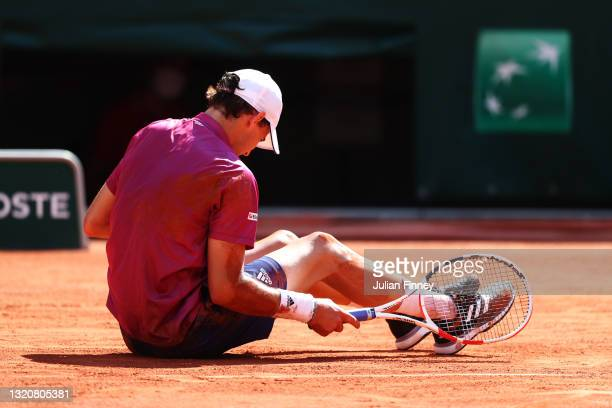 Dominic Thiem of Austria reacts after stretching for a shot in his First Round match against Pablo Andujar of Spain during Day One of the 2021 French...
