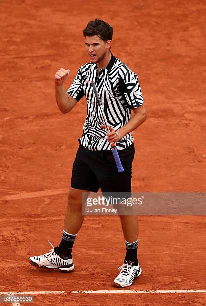 Dominic Thiem of Austria reacts during the Men's Singles quarter final match against David Goffin of Belgium on day twelve of the 2016 French Open at...