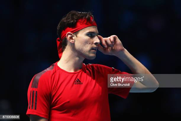 Dominic Thiem of Austria reacts in his Singles match against David Goffin of Belgium during day six of the Nitto ATP World Tour Finals at O2 Arena on...