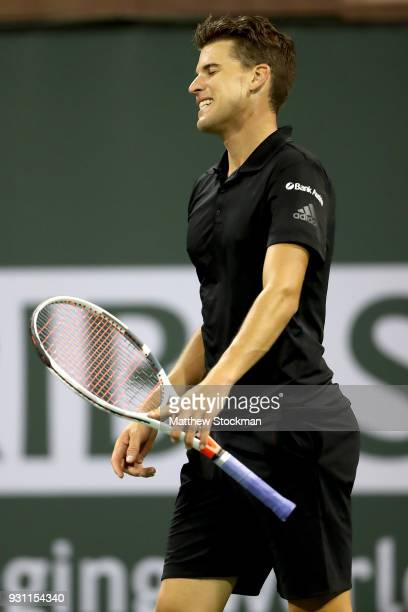 Dominic Thiem of Austria reacts to a lost point to Pablo Cuevas of Uraguay during the BNP Paribas Open at the Indian Wells Tennis Garden on March 12...