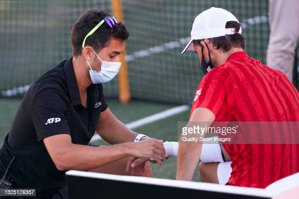 Dominic Thiem of Austria receives medical treatment during his Round of 16 match against Adrian Mannarino of France on day four of the Mallorca...