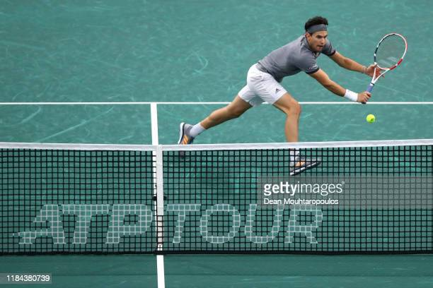 Dominic Thiem of Austria returns a backhand against Milos Raonic of Canada on day 3 of the Rolex Paris Masters, part of the ATP World Tour Masters...