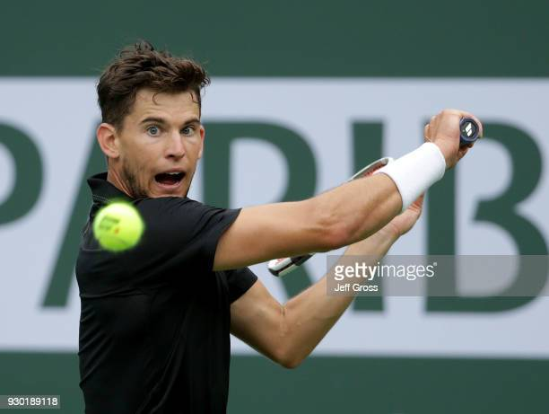 Dominic Thiem of Austria returns a backhand to Stefanos Tsitsipas of Greece during the BNP Paribas Open on March 10 2018 at the Indian Wells Tennis...