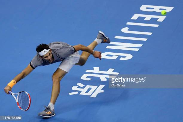 Dominic Thiem of Austria returns a shot against Karen Khachanov of Russia during the Men's singles Semifinals of 2019 China Open at the China...