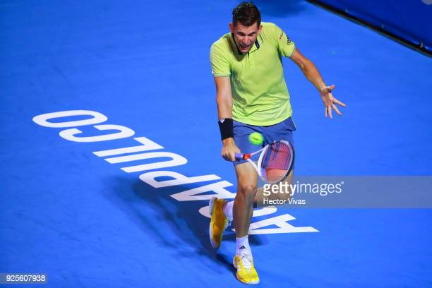 Dominic Thiem of Austria returns a shot during a match between Cameron Norrie of Great Britain and Dominic Thiem of Austria as part of the Telcel...