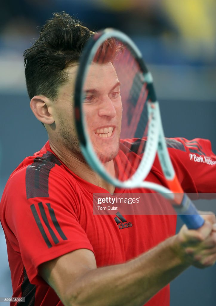Dominic Thiem of Austria returns a shot during his semi-final match against Kevin Anderson of South Africa on day two of the Mubadala World Tennis Championship at International Tennis Centre Zayed Sports City on December 29, 2017 in Abu Dhabi, United Arab Emirates.