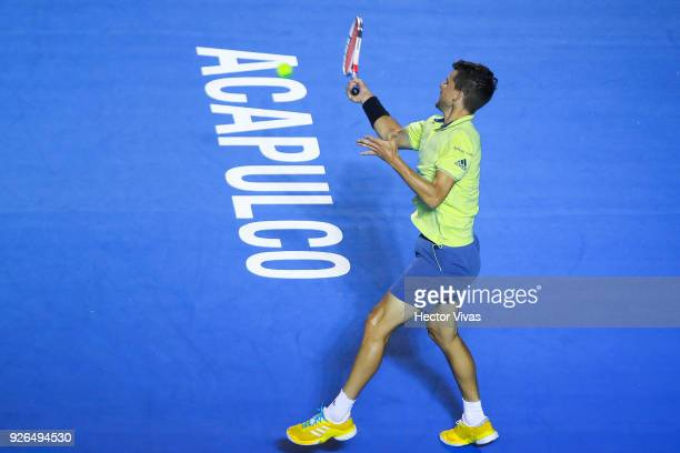 Dominic Thiem of Austria returns a shot during the match between Juan Martin del Potro of Argentina and Dominic Thiem of Austria as part of the...