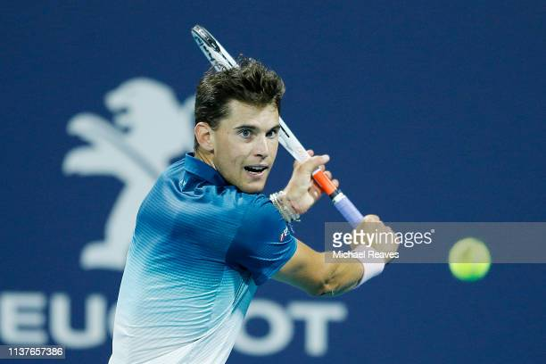 Dominic Thiem of Austria returns a shot to Hubert Hurkacz of Poland during Day 5 of the Miami Open Presented by Itau at Hard Rock Stadium on March 22...