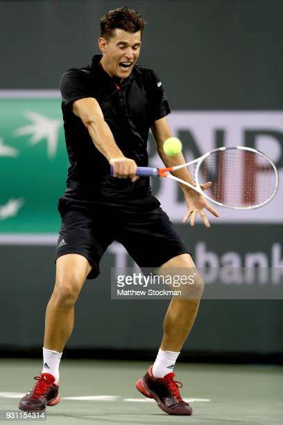 Dominic Thiem of Austria returns a shot to Pablo Cuevas of Uraguay during the BNP Paribas Open at the Indian Wells Tennis Garden on March 12 2018 in...