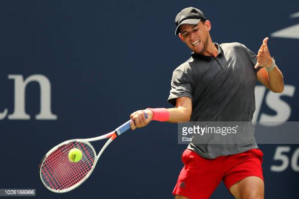 Dominic Thiem of Austria returns the ball during his men's singles fourth round match against Kevin Anderson of South Africa on Day Seven of the 2018...