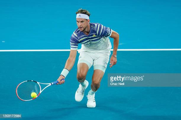 Dominic Thiem of Austria runs to the net to play a volley in his semi final match against Alexander Zverev of Germany on day twelve of the 2020...