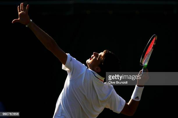 Dominic Thiem of Austria serves against Marcos Baghdatis of Cyprus during their Men's Singles first round match on day two of the Wimbledon Lawn...